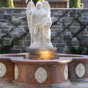 The Fountain marks the entrance of the Mourning Garden. It is shaped in a cross and is a sign of the living water of Baptism.